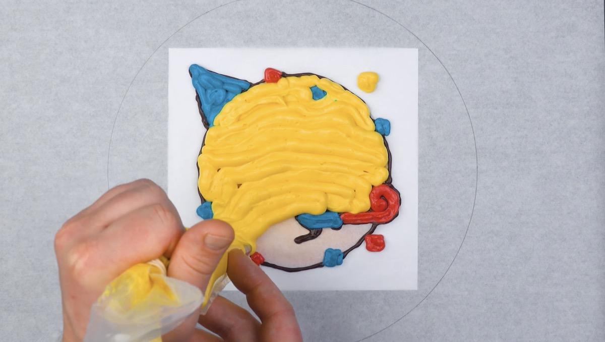 Glassa colorata su emoticon